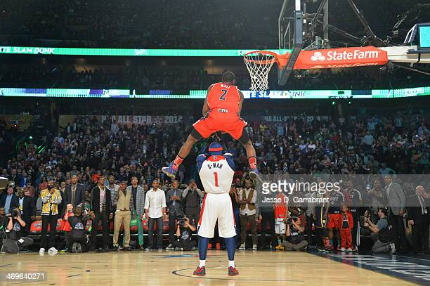 John Wall of the Washington Wizards dunks over the Wizards mascot during the Sprite Slam Dunk Contest on State Farm AllStar Saturday Night as part of...
