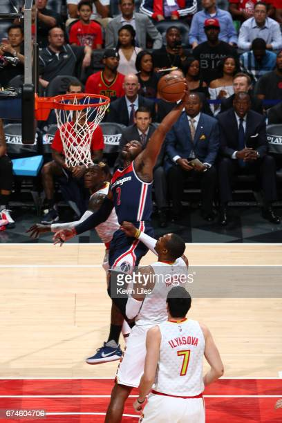John Wall of the Washington Wizards dunks the ball against the Atlanta Hawks in Game Six of the Eastern Conference Quarterfinals of the 2017 NBA...