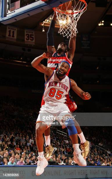 John Wall of the Washington Wizards dunks the ball over Baron Davis of the New York Knicks during the game on April 13 2012 at Madison Square Garden...