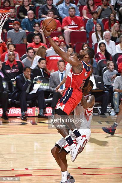 John Wall of the Washington Wizards goes for the layup during the game against the Houston Rockets on January 30 2016 at the Toyota Center in Houston...