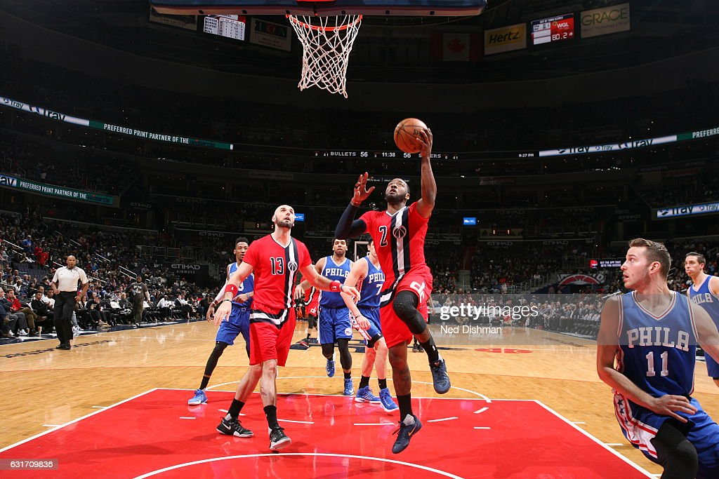 John Wall #2 of the Washington Wizards goes to the basket against the Philadelphia 76ers on January 14, 2017 at Verizon Center in Washington, DC.