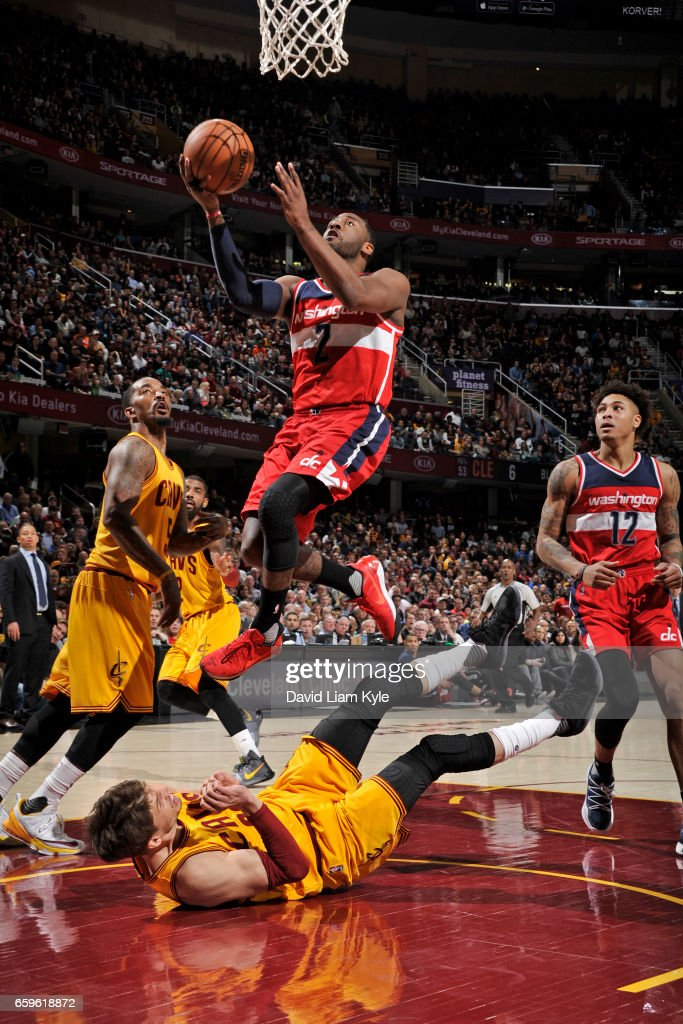 John Wall #2 of the Washington Wizards goes up for a lay up during a game against the Cleveland Cavaliers on March 25, 2017 at Quicken Loans Arena in Cleveland, Ohio.