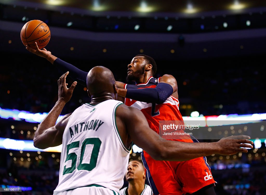 John Wall #2 of the Washington Wizards goes up for a layup in front of Joel Anthony #50 of the Boston Celtics in the second half during the game at TD Garden on April 16, 2014 in Boston, Massachusetts.