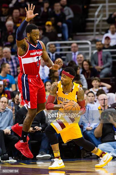 John Wall of the Washington Wizards guards Mo Williams of the Cleveland Cavaliers during the first half at Quicken Loans Arena on December 1 2015 in...