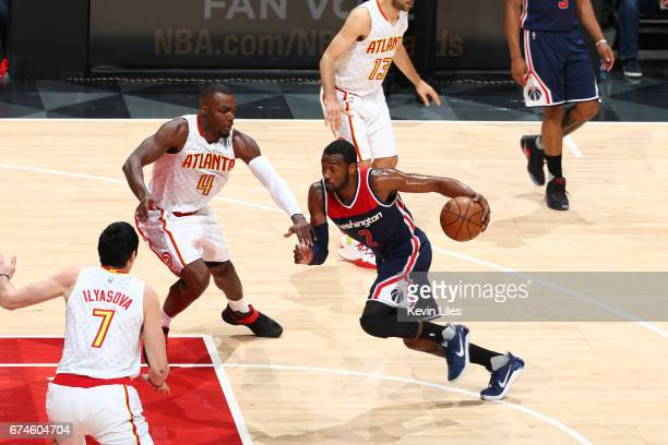 John Wall of the Washington Wizards handles the ball against the Atlanta Hawks in Game Six of the Eastern Conference Quarterfinals of the 2017 NBA...