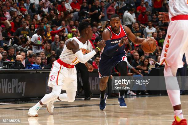 John Wall of the Washington Wizards handles the ball against the Atlanta Hawks during Game Four of the Eastern Conference Quarterfinals of the 2017...
