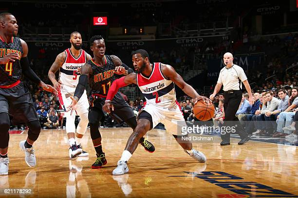 John Wall of the Washington Wizards handles the ball during a game against the Atlanta Hawks on November 4 2016 at the Verizon Center in Washington...