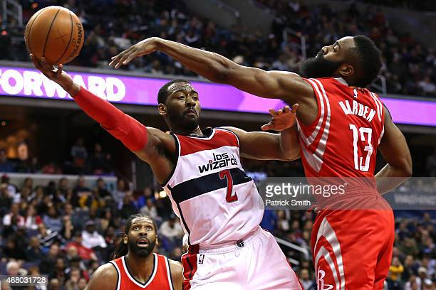 John Wall of the Washington Wizards is defended by James Harden of the Houston Rockets in the second half at Verizon Center on March 29 2015 in...