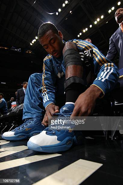 John Wall of the Washington Wizards laces his shoes before a game against the Dallas Mavericks at the Verizon Center on February 26 2011 in...