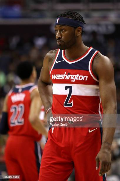 John Wall of the Washington Wizards looks on against the Charlotte Hornets during the second half at Capital One Arena on March 31 2018 in Washington...