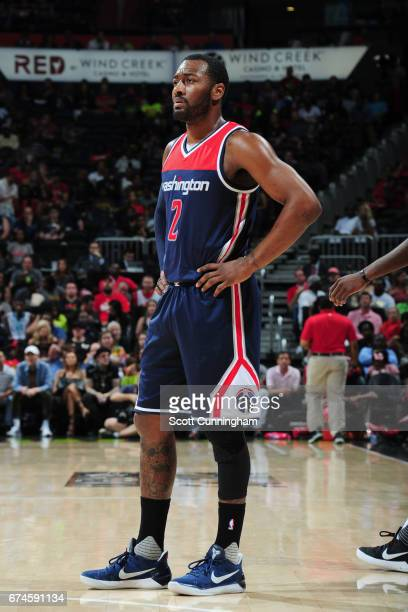 John Wall of the Washington Wizards looks on during the game against the Atlanta Hawks during Game Six of the Eastern Conference Quarterfinals of the...