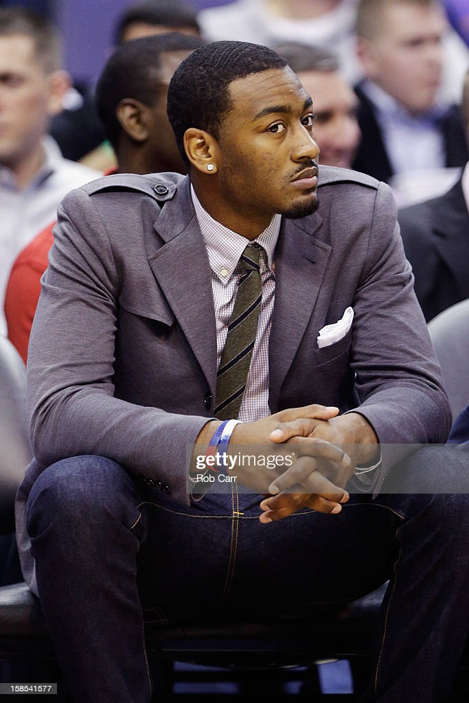 John Wall #2 of the Washington Wizards looks on from the bench during the first half of the Wizards game against the Atlanta Hawks at Verizon Center on December 18, 2012 in Washington, DC.