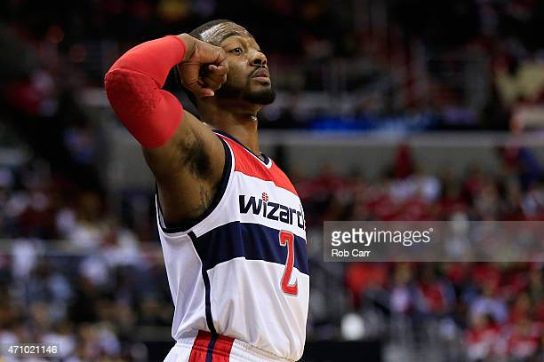 John Wall of the Washington Wizards motions from the floor in the second half of the Wizards 106-99 win over the Toronto Raptors during Game Three of...