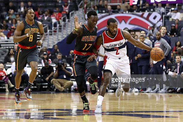 John Wall of the Washington Wizards moves the ball past Dennis Schroder of the Atlanta Hawks in the first half at Verizon Center on November 4 2016...