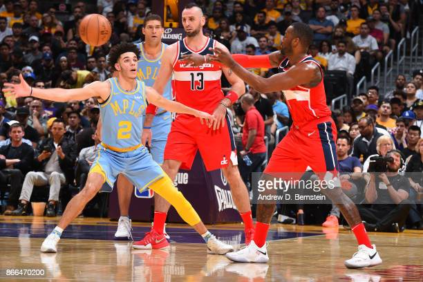 John Wall of the Washington Wizards passes the ball against Lonzo Ball of the Los Angeles Lakers on October 25 2017 at STAPLES Center in Los Angeles...