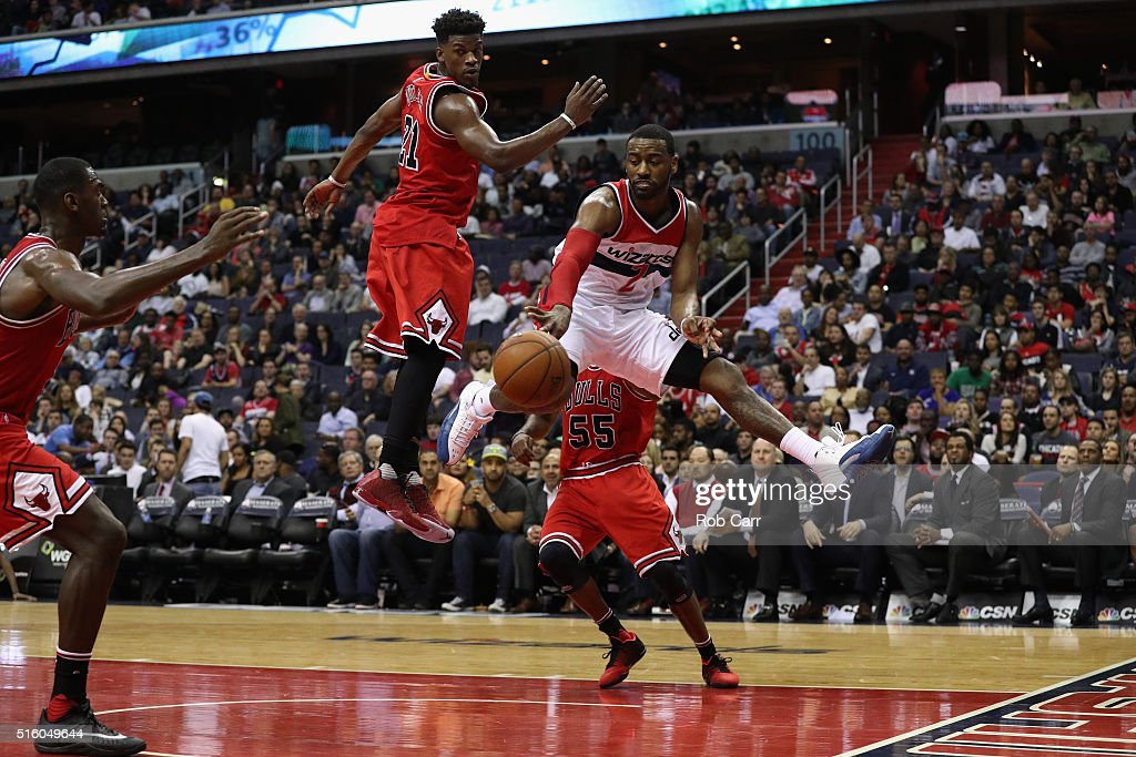 John Wall #2 of the Washington Wizards passes the ball in front of Jimmy Butler #21 of the Chicago Bulls in the second half of their 117-96 win at Verizon Center on March 16, 2016 in Washington, DC.