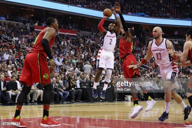 John Wall of the Washington Wizards puts up a shot against the Atlanta Hawks in Game Five of the Eastern Conference Quarterfinals during the 2017 NBA...