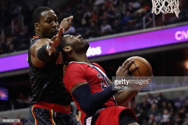 John Wall of the Washington Wizards puts up a shot in front of Dwight Howard of the Atlanta Hawks during the first half at Verizon Center on March 22...