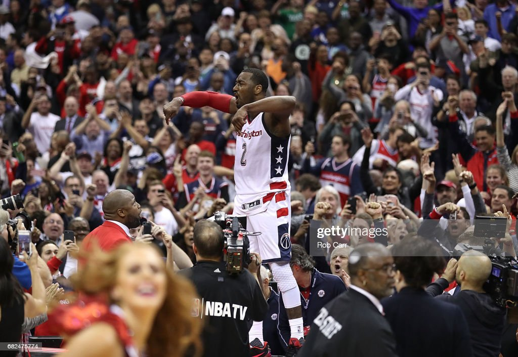 John Wall #2 of the Washington Wizards reacts after hitting the game-winning three-point basket in their 92-91 win over the Boston Celtics during Game Six of the NBA Eastern Conference Semi-Finals at Verizon Center on May 12, 2017 in Washington, DC.