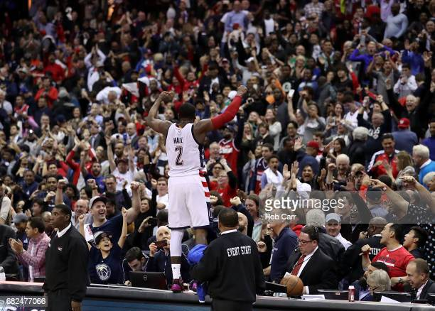 John Wall of the Washington Wizards reacts after hitting the gamewinning threepoint basket in their 9291 win over the Boston Celtics during Game Six...