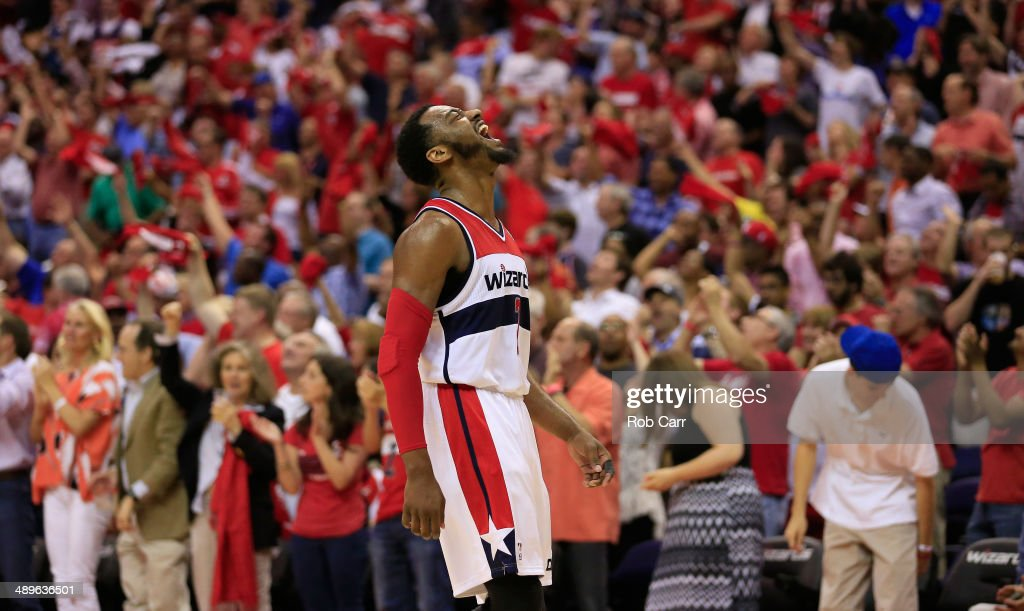 John Wall #2 of the Washington Wizards reacts after scoring to end the first half against the Indiana Pacers during Game Four of the Eastern Conference Semifinals during the 2014 NBA Playoffs at Verizon Center on May 11, 2014 in Washington, DC.
