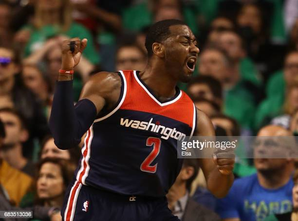 John Wall of the Washington Wizards reacts against the Boston Celtics during Game Seven of the NBA Eastern Conference SemiFinals at TD Garden on May...