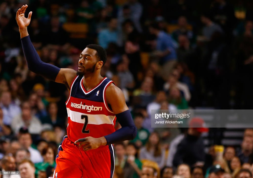 John Wall #2 of the Washington Wizards reacts following a three-point shot against the Boston Celtics in the second quarter during the game at TD Garden on April 16, 2014 in Boston, Massachusetts.
