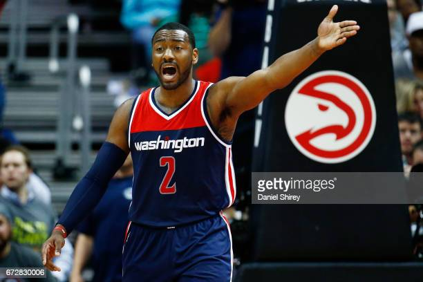 John Wall of the Washington Wizards reacts to a play during the fourth quarter against the Atlanta Hawks in Game Four of the Eastern Conference...