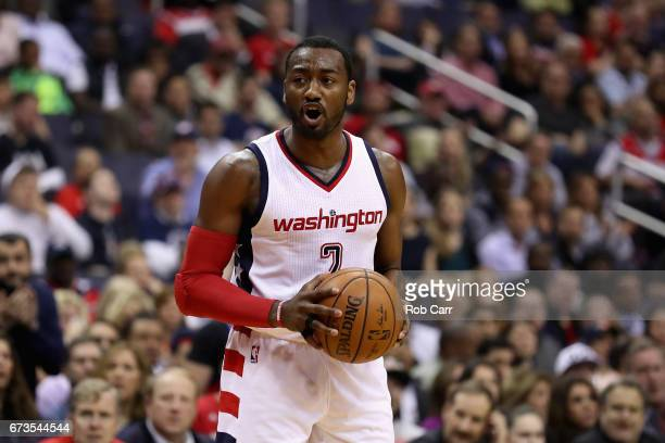 John Wall of the Washington Wizards reacts to an officials call against the Atlanta Hawks in the first half of Game Five of the Eastern Conference...