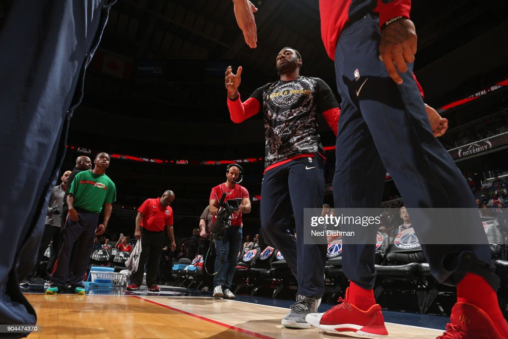 John Wall #2 of the Washington Wizards runs out before the game against the Orlando Magic on January 12, 2018 at Capital One Arena in Washington, DC.