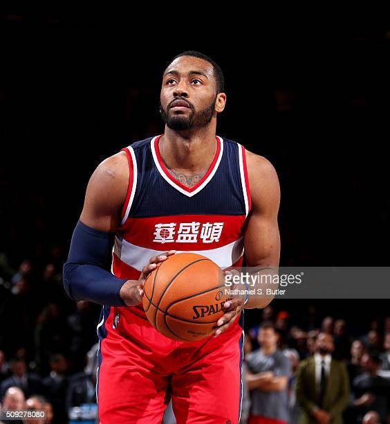 John Wall of the Washington Wizards shoots a free throw against the New York Knicks on February 9 2016 at Madison Square Garden in New York City New...