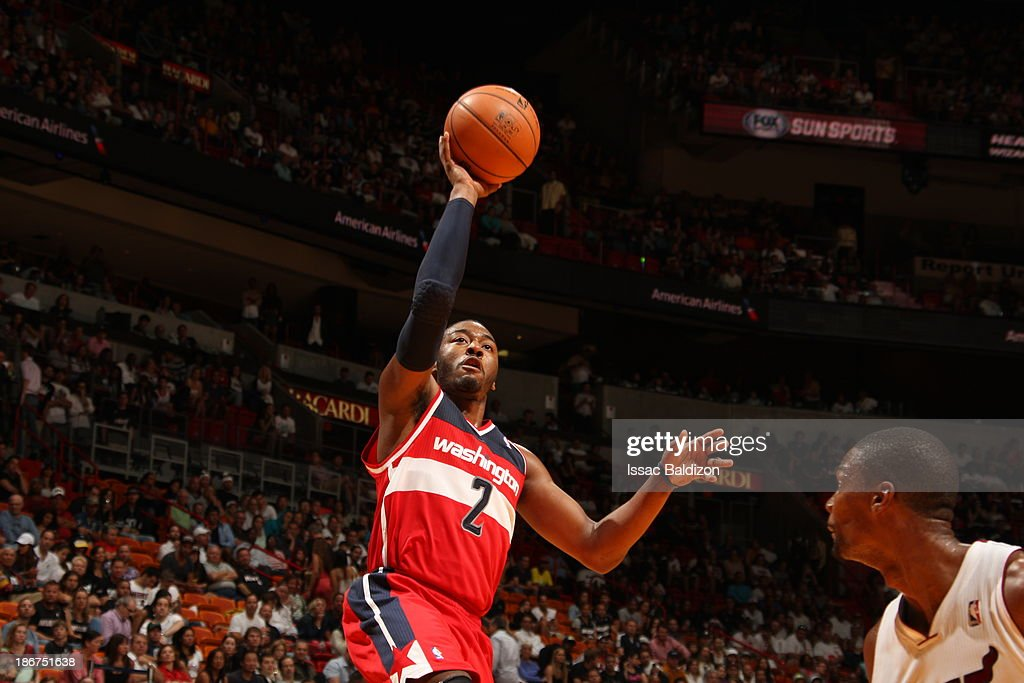 John Wall #2 of the Washington Wizards shoots against the Miami Heat on November 3, 2013 at American Airlines Arena in Miami, Florida.