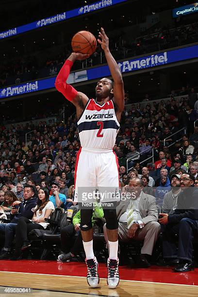 John Wall of the Washington Wizards shoots against the Sacramento Kings at the Verizon Center on February 9 2014 in Washington DC NOTE TO USER User...