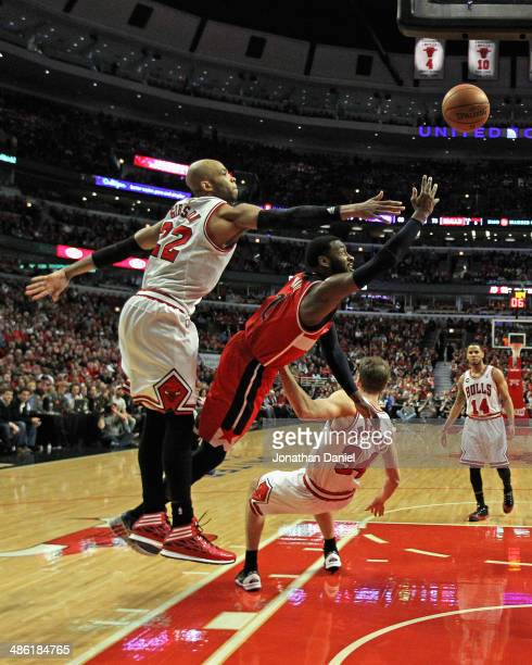 John Wall of the Washington Wizards shoots between Taj Gibson and Mike Dunleavy of the Chicago Bulls in Game Two of the Eastern Conference...