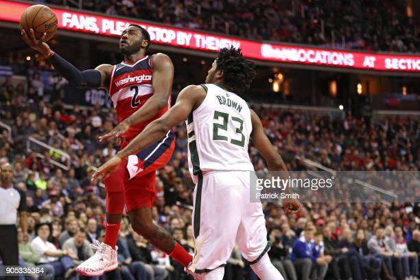 John Wall of the Washington Wizards shoots the ball in front of Sterling Brown of the Milwaukee Bucks during the second half at Capital One Arena on...