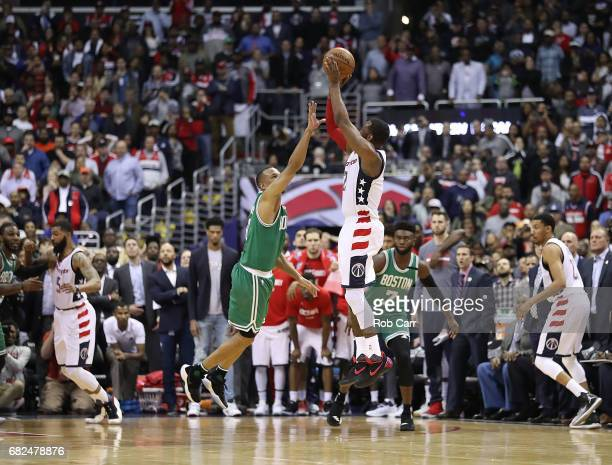 John Wall of the Washington Wizards shoots the gamewinning threepoint basket against Avery Bradley of the Boston Celtics during Game Six of the NBA...