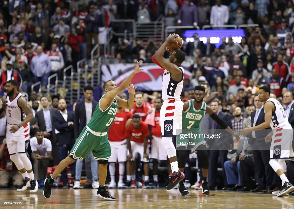 John Wall #2 of the Washington Wizards shoots the game-winning three-point basket against Avery Bradley #0 of the Boston Celtics during Game Six of the NBA Eastern Conference Semi-Finals at Verizon Center on May 12, 2017 in Washington, DC.