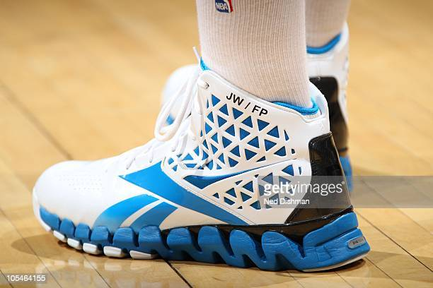 John Wall of the Washington Wizards shows off his sneakers against the Milwaukee Bucks at the Verizon Center on October 14 2010 in Washington DC NOTE...