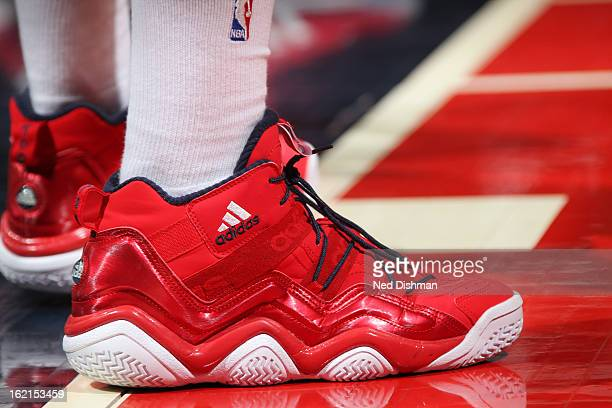 John Wall of the Washington Wizards shows off his sneakers during the game against the Toronto Raptors at the Verizon Center on February 19 2013 in...