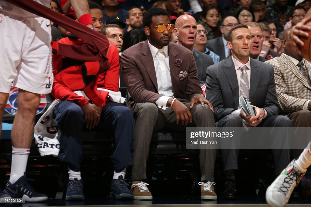 John Wall #2 of the Washington Wizards sits on the bench during the game against the Minnesota Timberwolves on March 13, 2018 at Capital One Arena in Washington, DC.