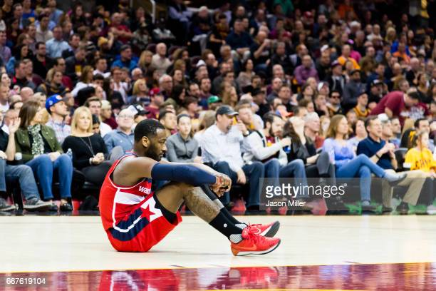John Wall of the Washington Wizards sits on the court between plays during the first half against the Cleveland Cavaliers at Quicken Loans Arena on...
