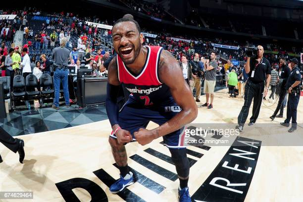 John Wall of the Washington Wizards smiles after the game against the Atlanta Hawks during Game Six of the Eastern Conference Quarterfinals of the...