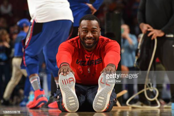 John Wall of the Washington Wizards smiles and stretches on the court before the game against the Philadelphia 76ers on November 30, 2018 at the...