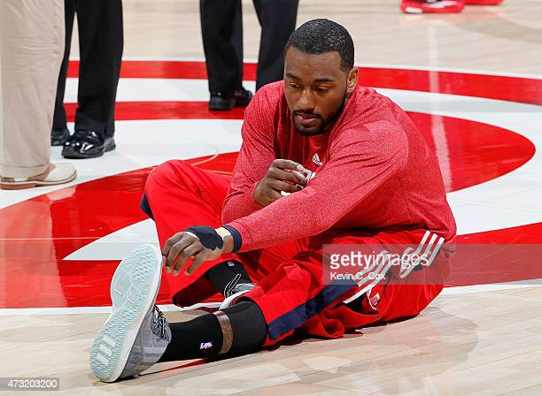 John Wall of the Washington Wizards stretches prior to warming up for Game Five of the Eastern Conference Semifinals of the 2015 NBA Playoffs against...