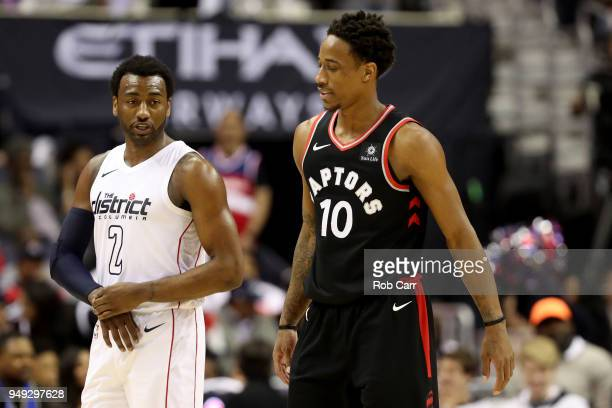 John Wall of the Washington Wizards talks with DeMar DeRozan of the Toronto Raptors in the second half during Game Three of Round One of the 2018 NBA...