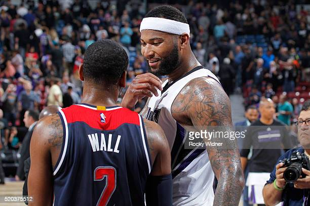 97a05f8f6227 John Wall of the Washington Wizards talks with DeMarcus Cousins of the  Sacramento Kings after the