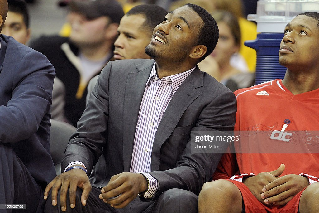 John Wall #2 of the Washington Wizards watches his team from the bench during the second half against the Cleveland Cavaliers at Quicken Loans Arena on October 30, 2012 in Cleveland, Ohio.