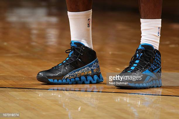 John Wall of the Washington Wizards wearing 'Great Wall of China' Reebok sneakers against the Portland Trail Blazers at the Verizon Center on...