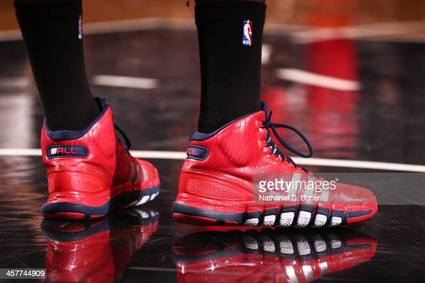 John Wall of the Washington Wizards wears custom Adidas sneakers during a game against the Brooklyn Nets at the Barclays Center on December 18 2013...