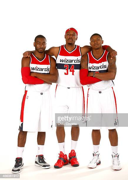 John Wall Paul Pierce and Bradley Beal of the Washington Wizards pose for a portrait during Media Day at the Verizon Center on September 29 2014 in...